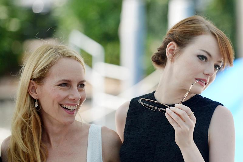 """Actresses Amy Ryan (L) and Emma Stone arrive for the photocall of the movie """"Birdman or the Unexpected Virtue of Ignorance"""" on the opening day of the Venice Film Festival on August 27, 2014 (AFP Photo/Tiziana Fabi)"""