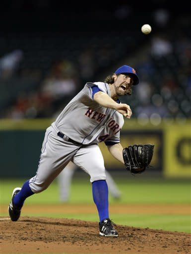 New York Mets starting pitcher R.A. Dickey delivers a pitch against the Houston Astros during the fifth inning of a baseball game Monday, April 30, 2012, in Houston. (AP Photo/David J. Phillip)