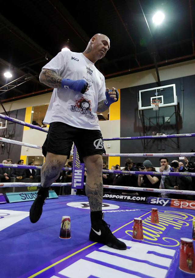 Boxing - Dillian Whyte & Lucas Browne Media Work-Outs - The Third Space, London, Britain - March 20, 2018 Lucas Browne with plastic cups laid out in the ring during his work out Action Images via Reuters/Andrew Couldridge