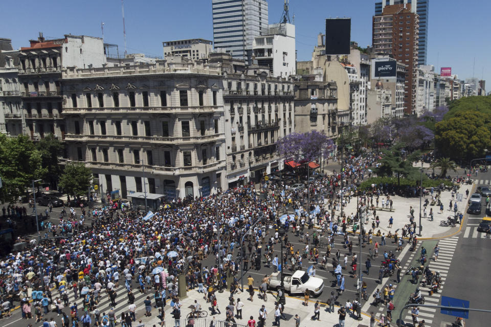 Police block access to people who were waiting to pay final respects to Diego Maradona lying in state at the presidential palace, in Buenos Aires, Argentina, Thursday, Nov. 26, 2020. The Argentine soccer great who led his country to the 1986 World Cup title died Wednesday at the age of 60. (AP Photo/Mario De Fina)