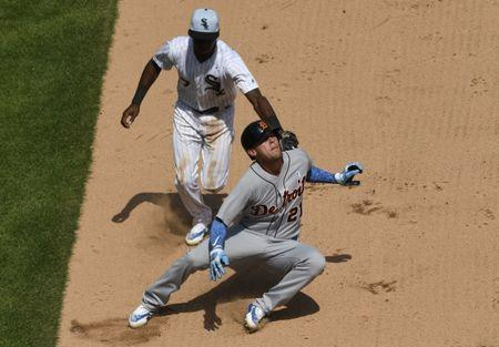 Jun 17, 2018; Chicago, IL, USA; Detroit Tigers center fielder JaCoby Jones (21) is tagged out by Chicago White Sox shortstop Tim Anderson (7) after being picked-off on a steal attempt of second base during the seventh inning at Guaranteed Rate Field. Mandatory Credit: David Banks-USA TODAY Sports