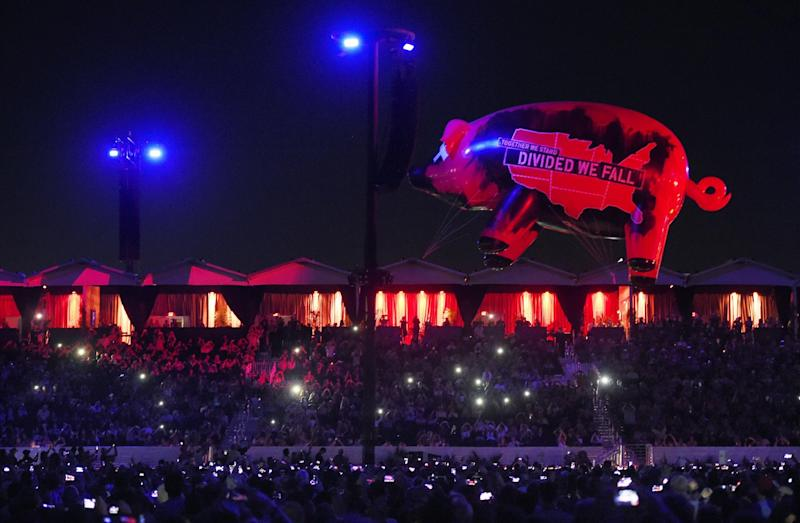 An inflatable pig flies above the crowd during Roger Waters' closing performance on day 3 of the 2016 Desert Trip music festival at Empire Polo Field on Sunday, Oct. 9, 2016, in Indio, Calif. (Photo by Chris Pizzello/Invision/AP)