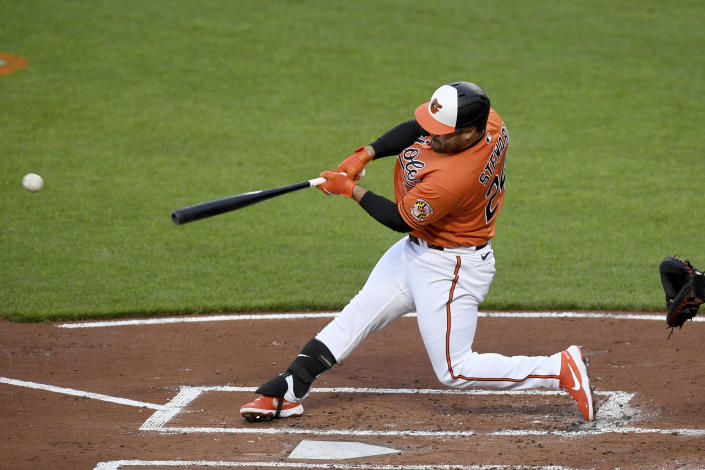 Baltimore Orioles' DJ Stewart hits an RBI-single against the Boston Red Sox in the first inning of a baseball game, Saturday, May 8, 2021, in Baltimore. (AP Photo/Will Newton)