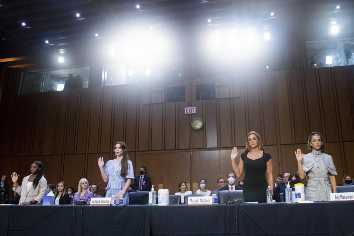 From left, U.S. gymnasts Simone Biles, McKayla Maroney, Maggie Nichols, and Aly Raisman are sworn in to testify during a Senate Judiciary Committee hearing on Wednesday, September 15, 2021. / Credit: Saul Loeb / AP