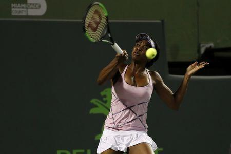 Mar 27, 2017; Miami, FL, USA; Venus Williams of the United States hits a forehand against Svetlana Kuznetsova of Russia (not pictured) on day seven of the 2017 Miami Open at Crandon Park Tennis Center. Williams won 6-3, 7-6(4). Mandatory Credit: Geoff Burke-USA TODAY Sports