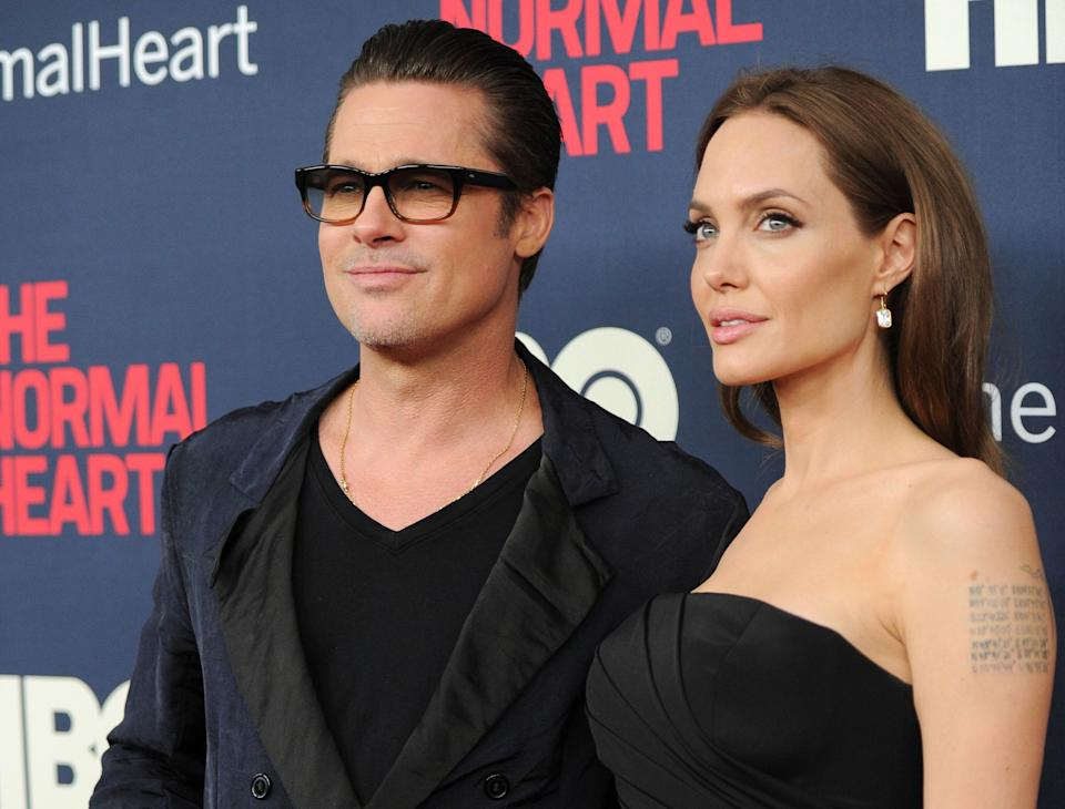 """FILE - In this May 12, 2014 file photo, Brad Pitt and Angelina Jolie attend the premiere of HBO Films' """"The Normal Heart"""" at the Ziegfeld Theatre in New York. Jolie and Pitt are officially single, though more work is left before the terms of their divorce are final. Los Angeles Superior Court documents show that Judge John W. Ouderkirk entered a judgment Friday, April 12, 2019, saying the couple is no longer married.  (Photo by Evan Agostini/Invision/AP, File)"""