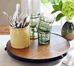 """<p>$35</p><p><a class=""""link rapid-noclick-resp"""" href=""""https://go.redirectingat.com?id=74968X1596630&url=https%3A%2F%2Fwww.potterybarn.com%2Fproducts%2Fblacksmith-kitchen-wood-metal-lazy-susan%2F&sref=http%3A%2F%2Fwww.womansday.com%2Flife%2Fg955%2Fgifts-for-her%2F"""" rel=""""nofollow noopener"""" target=""""_blank"""" data-ylk=""""slk:SHOP NOW"""">SHOP NOW</a></p><p>She'll never have to reach over the table for a <a href=""""https://www.womansday.com/food-recipes/a23303738/heinz-mayochup/"""" rel=""""nofollow noopener"""" target=""""_blank"""" data-ylk=""""slk:condiment"""" class=""""link rapid-noclick-resp"""">condiment</a> again with this rustic Lazy Susan. </p>"""
