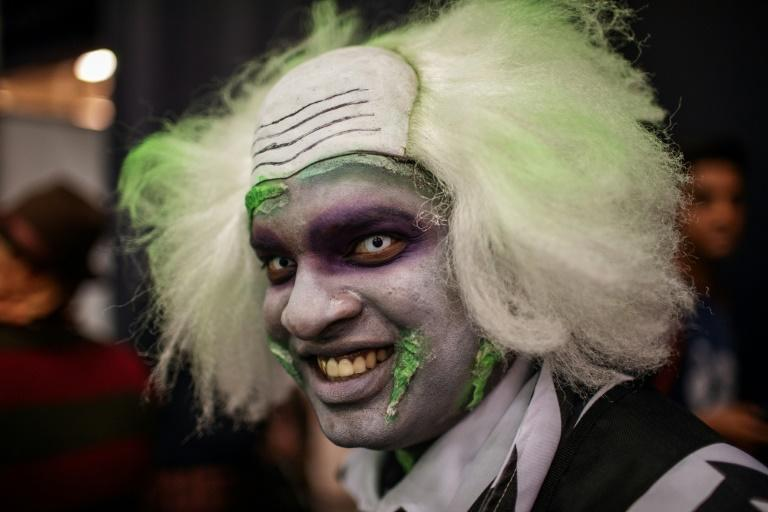 Cosplayers dress as their favourite superheroes - or villains (AFP Photo/Michele Spatari)