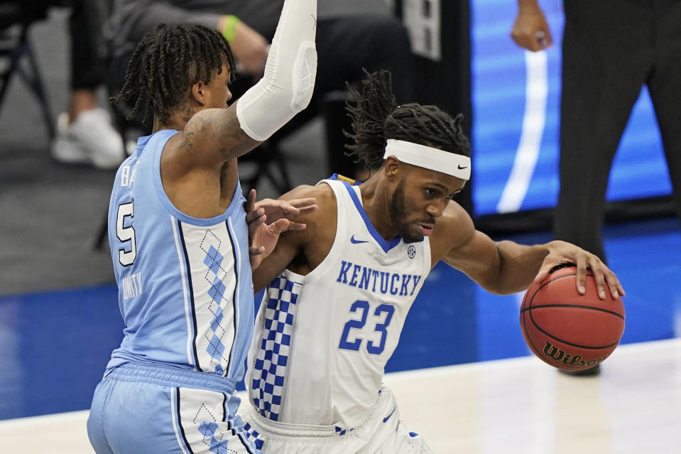 Kentucky's Isaiah Jackson (23) drives past North Carolina's Armando Bacot (5) in the second half of an NCAA college basketball game, Saturday, Dec. 19, 2020, in Cleveland. (AP Photo/Tony Dejak)