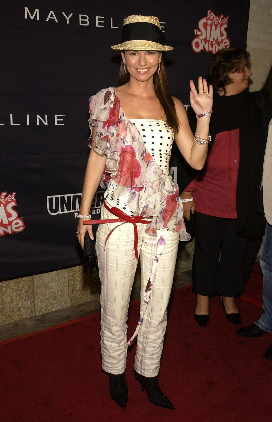 <p>Shania opted for a polka-dot top featuring a cross-body chunk of floral at a Teen People and Universal Records event honoring Nelly.</p>