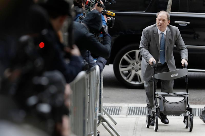 Harvey Weinstein greets reporters as he arrives at court for jury instructions in his sex-crimes trial in New York, Feb. 18, 2020.