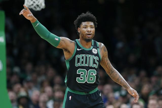 Boston Celtics' Marcus Smart plays against the Oklahoma City Thunder during the first half of an NBA basketball game, Sunday, March, 8, 2020, in Boston. (AP Photo/Michael Dwyer)