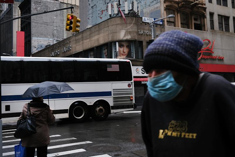 NEW YORK, NY - MAY 08: People walk along Broadway as the coronavirus keeps financial markets and businesses mostly closed on May 08, 2020 in New York City. The Bureau of Labor Statistics announced on Friday that the US economy lost 20.5 million jobs in April. This is the largest decline in jobs since the government began tracking the data in 1939. (Photo by Spencer Platt/Getty Images)