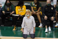 "Baylor head coach Kim Mulkey is shown during the second half of an NCAA women's college basketball game against South Florida Tuesday, Dec. 1, 2020, in Tampa, Fla. No. 6 Baylor canceled its much-anticipated home game Thursday night against No. 3 UConn after Lady Bears coach Kim Mulkey tested positive for COVID-19. I immediately self-quarantined and did not re-join the team when our staff and players came back from our holiday break on December 28,"" Mulkey said in a statement Tuesday, Jan. 5, 2021. (AP Photo/Chris O'Meara)"