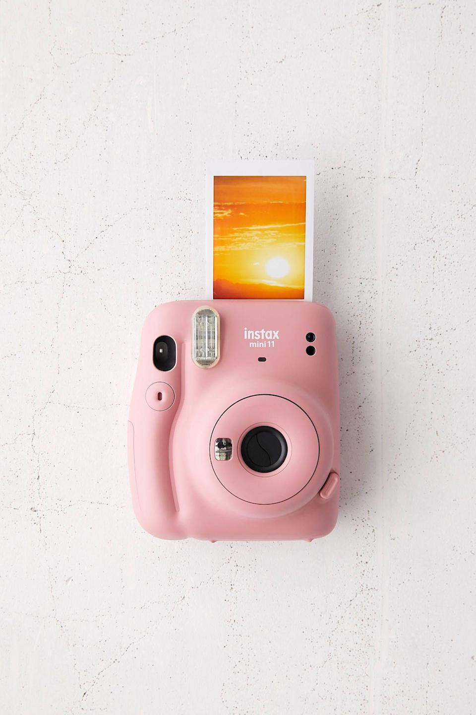 """<p><strong>Fujifilm</strong></p><p>urbanoutfitters.com</p><p><strong>$79.00</strong></p><p><a href=""""https://go.redirectingat.com?id=74968X1596630&url=https%3A%2F%2Fwww.urbanoutfitters.com%2Fshop%2Ffujifilm-uo-exclusive-instax-mini-11-instant-camera&sref=https%3A%2F%2Fwww.countryliving.com%2Fshopping%2Fgifts%2Fg2077%2Fchristmas-presents%2F"""" rel=""""nofollow noopener"""" target=""""_blank"""" data-ylk=""""slk:Shop Now"""" class=""""link rapid-noclick-resp"""">Shop Now</a></p><p>Capture memories -- big or small -- with this little camera. </p>"""