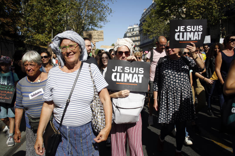 "Protestors hols boards reading ""I am climate"" during a climate demonstration, in Paris, Saturday, Sept. 21, 2019. Scuffles broke out in Paris between some violent activists and police which responded with tear gas at a march for climate gathering thousands of people in Paris. (AP Photo/Thibault Camus)"