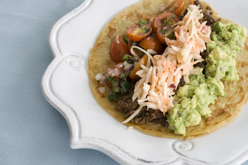 n this image taken on March 4, 2013, tortillas with tomato-mint salsa and guacamole are shown served on a plate in Concord, N.H. (AP Photo/Matthew Mead)