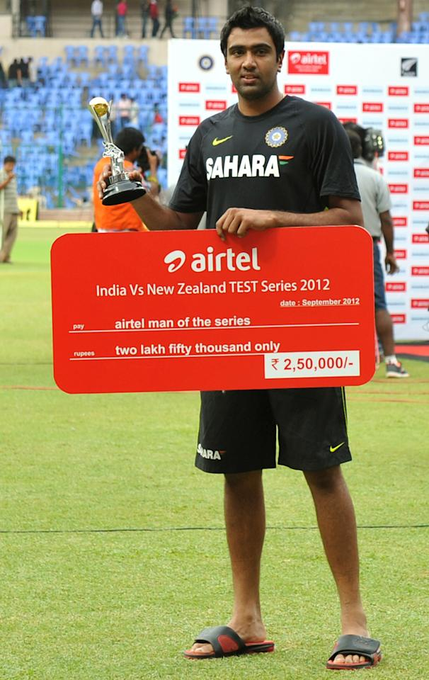 Indian cricketer Ravichandran Ashwin poses for a photograph after collecting the man of the series award after the team's victory in the second Test cricket match between India and New Zealand at the M. Chinnaswamy Stadium in Bangalore on September 3, 2012.  AFP PHOTO / Manjunath KIRAN