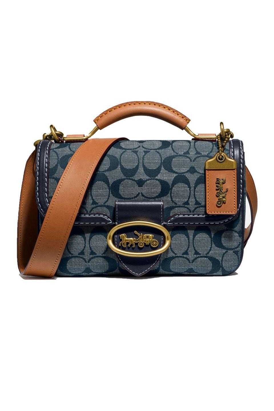 "<p>We always appreciate Coach's design nods to its <a href=""https://www.elle.com/fashion/shopping/g31251265/coach-originals-archive-bags/"" rel=""nofollow noopener"" target=""_blank"" data-ylk=""slk:past"" class=""link rapid-noclick-resp"">past</a>. The brand balances heritage silhouettes with modern needs—like expandable interiors and a detachable shoulder strap. This denim chambray is a fabric you won't be <em>too</em> precious about wearing on the daily. </p><p><em>Coach Riley Satchel, $595; coach.com</em></p><p><a class=""link rapid-noclick-resp"" href=""https://go.redirectingat.com?id=74968X1596630&url=https%3A%2F%2Fwww.coach.com%2Fcoach-riley-top-handle-22-in-signature-chambray%2F3630.html%3Fdwvar_color%3DB4RA3%26cgid%3Dwomen&sref=https%3A%2F%2Fwww.elle.com%2Ffashion%2Fshopping%2Fg33416567%2Fdesigner-it-bags-pre-fall-2021%2F"" rel=""nofollow noopener"" target=""_blank"" data-ylk=""slk:SHOP NOW"">SHOP NOW</a></p>"