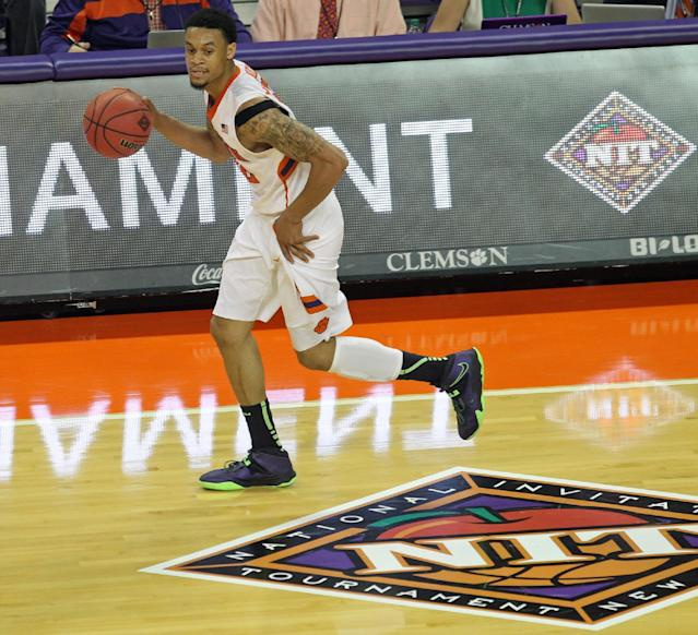Clemson's K.J. McDaniels dribbles upcourt in the first half of an NCAA college basketball National Invitational Tournament game against Georgia State at Littlejohn Coliseum in Clemson, S.C. on Tuesday March 18, 2014. (AP Photo/Anderson Independent-Mail, Mark Crammer)