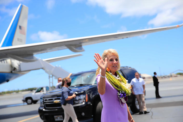 First lady Jill Biden waves to the media on the tarmac after arriving at Joint Base Pearl Harbor-Hickam, Hawaii, Saturday, July 24, 2021. (Jamm Aquino/Honolulu Star-Advertiser via AP)
