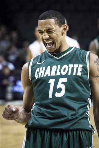 Charlotte's Pierria Henry reacts after shooting the game winning free-throws late in the second half of an NCAA college basketball game against Richmond in the Atlantic 10 Conference tournament, Thursday , March 14, 2013, in New York. Charlotte won 68-63. (AP Photo/John Minchillo)