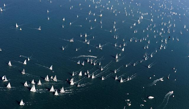 Sailing boats gather during the Barcolana regatta in front of Trieste harbour, Italy October 8, 2017. REUTERS/Stefano Rellandini