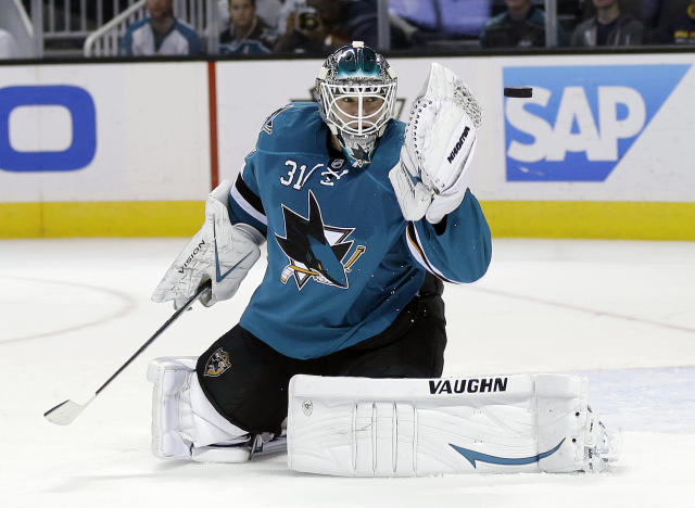 San Jose Sharks goalie Antti Niemi, of Finland, deflects a shot on goal bythe Los Angeles Kings during the second period of an NHL hockey game on Wednesday, Nov. 27, 2013, in San Jose, Calif. (AP Photo/Marcio Jose Sanchez)