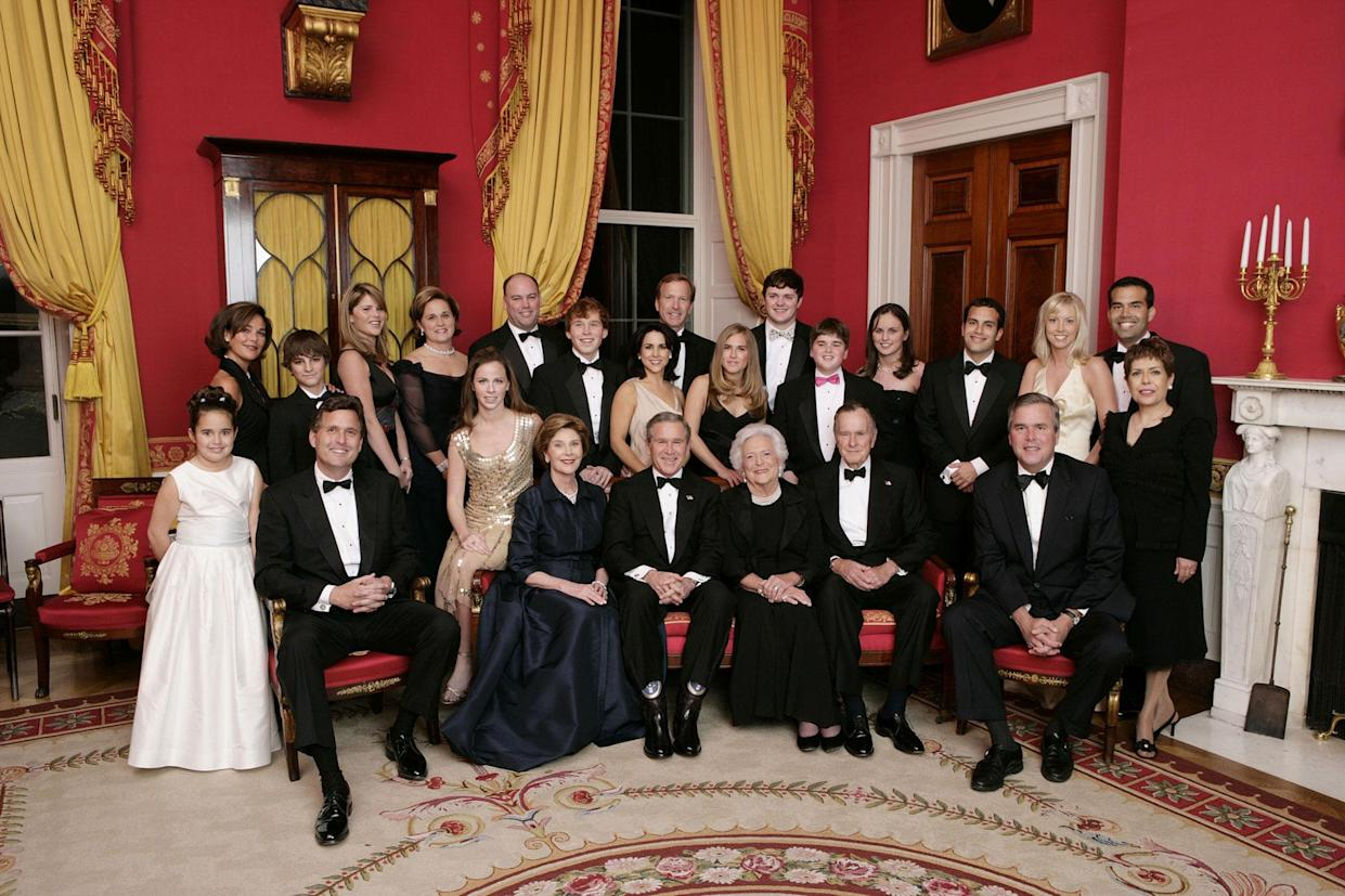 President George W. Bush, first lady Laura Bush, former first lady Barbara Bush and former President George H.W. Bush sit surrounded by family in the Red Room of the White House, Jan. 6, 2005. (Photo: Eric Draper/White House via Getty Images)