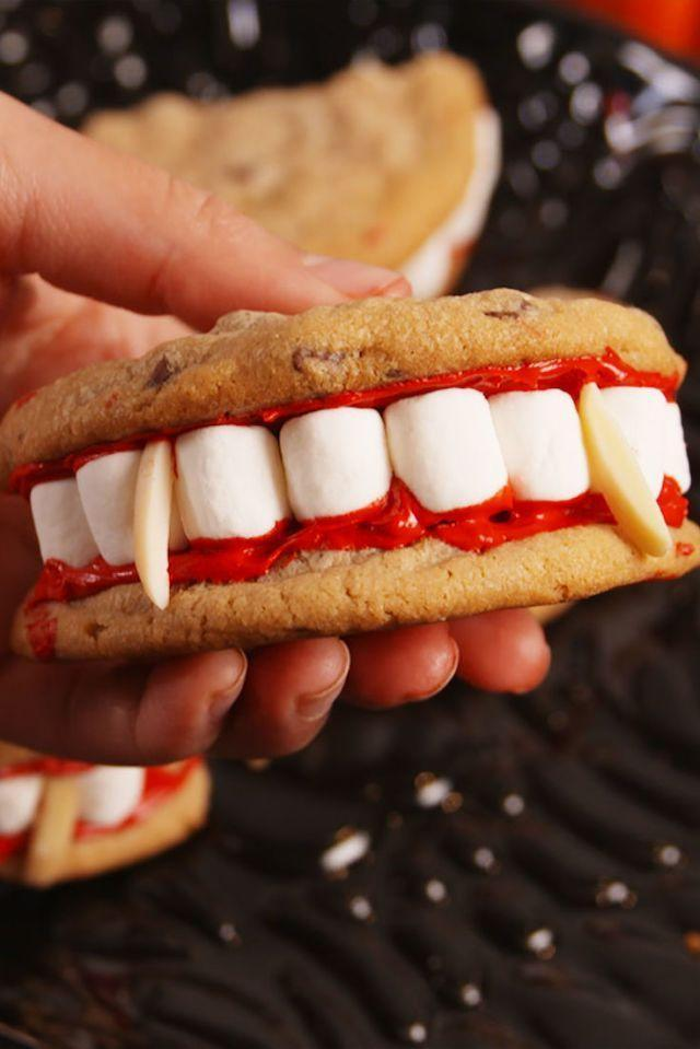 """<p>The only thing better than one cookie? Two cookies of course!</p><p><strong><em>Get the recipe at <a href=""""https://www.delish.com/cooking/recipe-ideas/recipes/a55668/dracula-dentures-recipe/"""" rel=""""nofollow noopener"""" target=""""_blank"""" data-ylk=""""slk:Delish"""" class=""""link rapid-noclick-resp"""">Delish</a>. </em></strong></p>"""