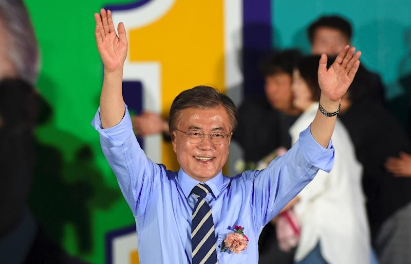 Pro-democracy activist Moon Jae-In, the projected winner of South Korea's presidential election shown at a campaign rally, backs engagement with the nuclear-armed North