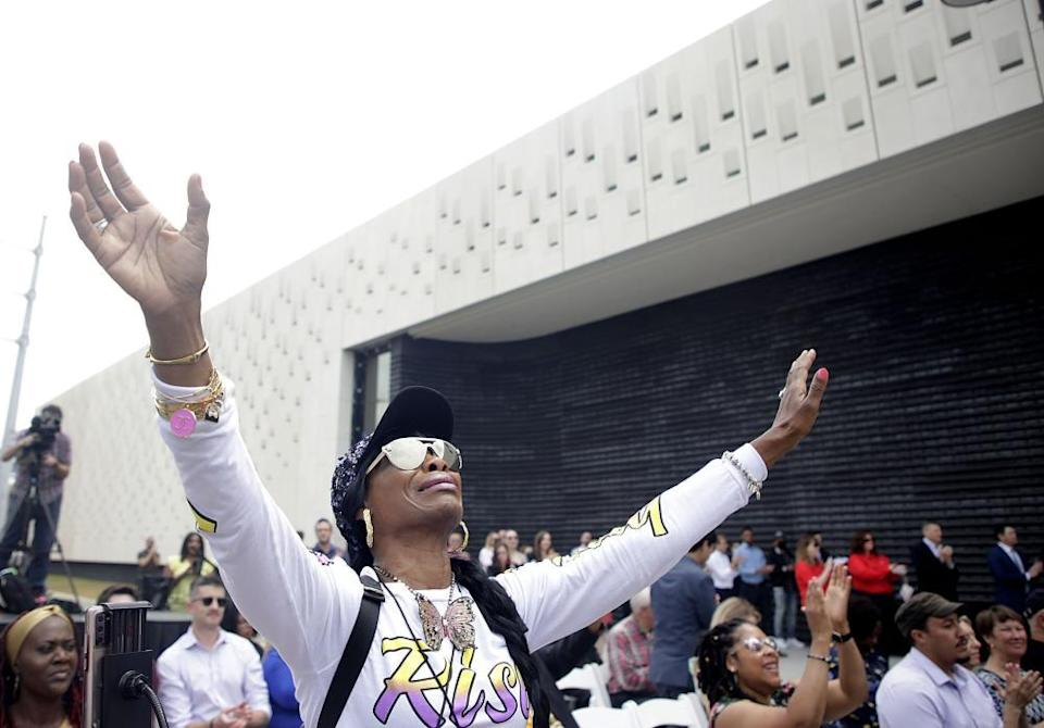 Chrisma Jewels reacts to music during a dedication ceremony for Greenwood Rising Black Wall Street History Center Wednesday, June 2, 2021 in Tulsa, Okla.