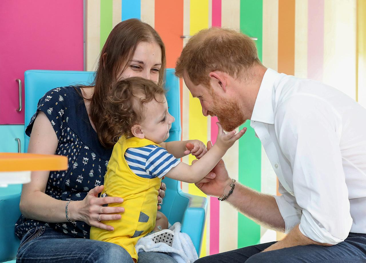 """Noah Nicholson, almost 2 years old, was fascinated by the prince's orange beard.  Noah, who has spent most of his life in hospital after being born at 27 weeks, gave the beard a tug when Harry leaned in close to him.  """"Have you never seen a beard before?"""" said Harry."""