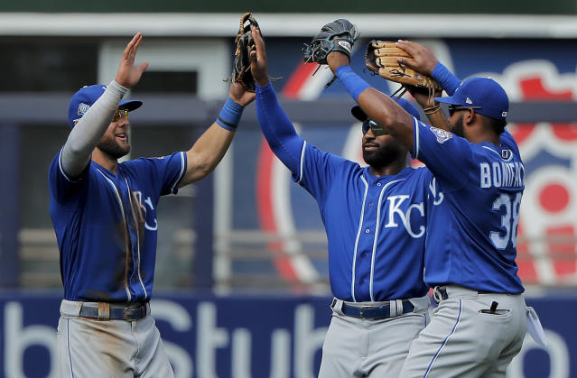 Kansas City Royals left fielder Alex Gordon, left, center fielder Brian Goodwin, center, and right fielder Jorge Bonifacio (38) celebrate after the Royals defeat the New York Yankees 10-5 in the first baseball game of a double header, Saturday, July 28, 2018, in New York. (AP Photo/Julie Jacobson)