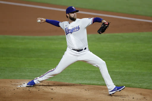 Texas Rangers starting pitcher Jordan Lyles throws to the San Diego Padres in the first inning of an interleague baseball game in Arlington, Texas, Monday Aug. 17, 2020. (AP Photo/Tony Gutierrez)