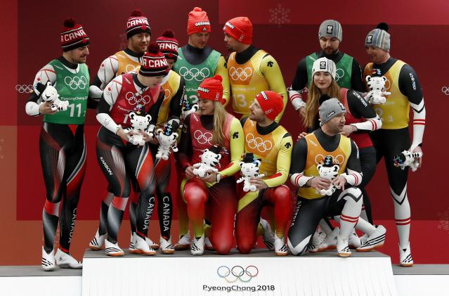 Luge - Pyeongchang 2018 Winter Olympic Games - Team Relay - Pyeongchang, South Korea - February 15, 2018 - Gold medalists Natalie Geisenberger, Johannes Ludwig, Tobias Wendl and Tobias Arlt of Germany, silver medalists Alex Gough, Sam Edney, Tristan Walker and Justin Snith of Canada, bronze medalists Madeleine Egle, David Gleirscher, Peter Penz and Georg Fischler of Austria during the victory ceremony. REUTERS/Edgar Su