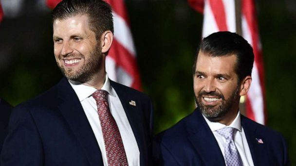 PHOTO: Eric Trump and Donald Trump Jr. are seen onstage ahead of President Donald Trump's acceptance speech for the Republican Party nomination for reelectionon the South Lawn of the White House, Aug. 27, 2020. (Brendan Smialowski/AFP via Getty Images)