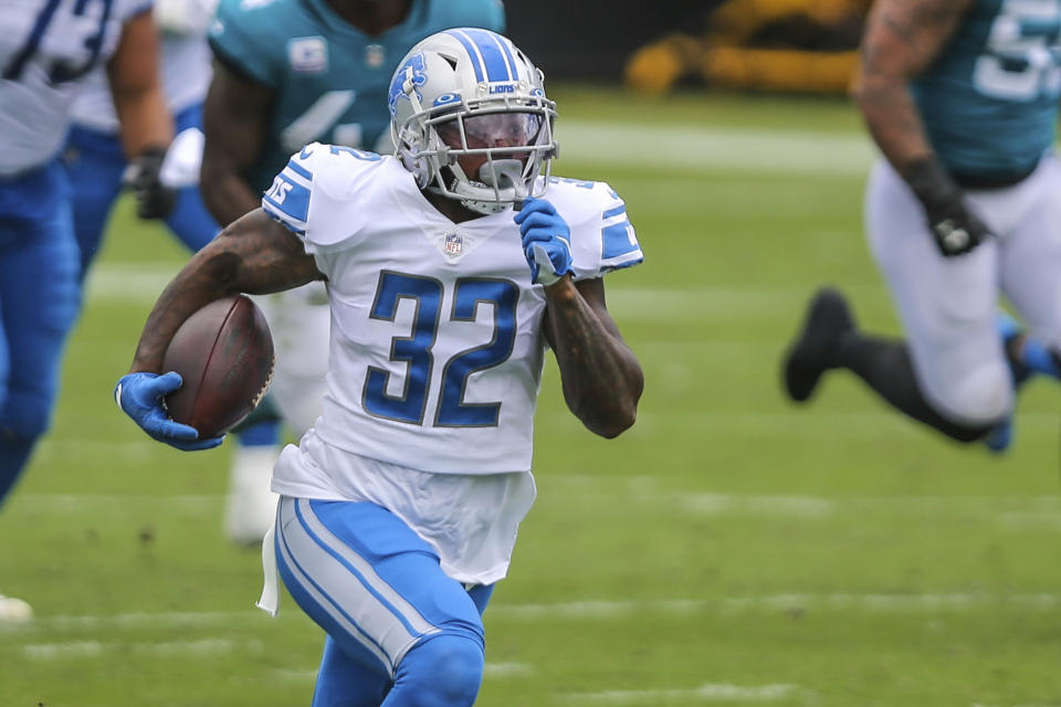Running back D'Andre Swift (32) is one of the Lions' interesting young players. (AP Photo/Gary McCullough, File)