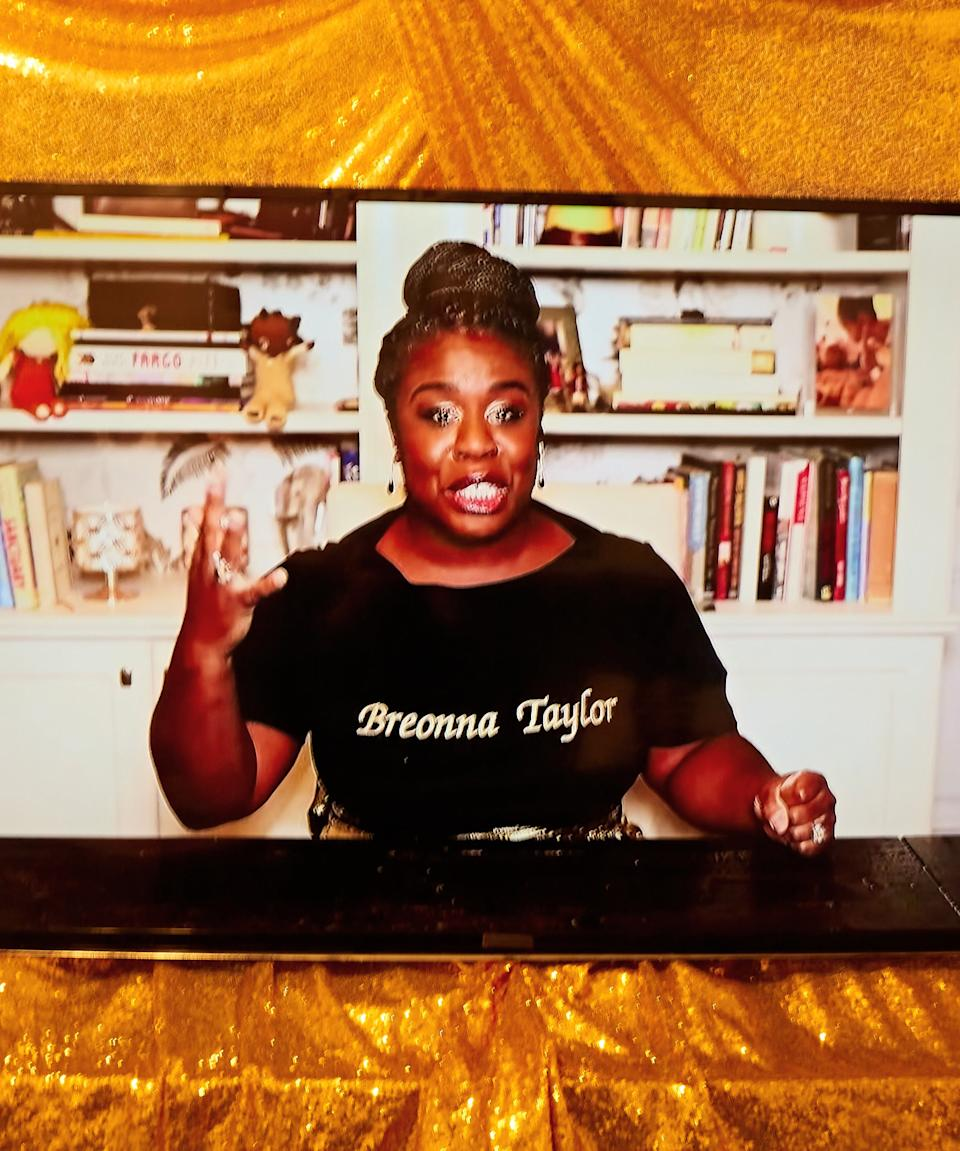 """<h2>Uzo Aduba</h2><br><em>Mrs. America</em> star Uzo Aduba sparkled as she accepted her Emmy for Outstanding Supporting Actress in a Limited Series or Movie while wearing a glittering gold skirt and a matching T-shirt that was etched with the name Breonna Taylor on it. <span class=""""copyright"""">Photographed by Joel Arbaje for Refinery29.</span>"""