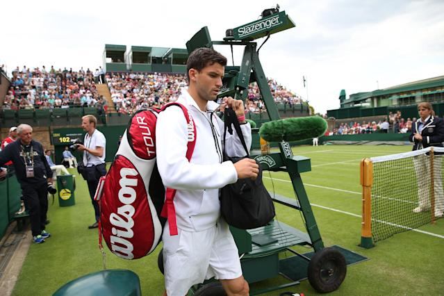 LONDON, ENGLAND - JUNE 25: Grigor Dimitrov of Bulgaria arrives on court before his Gentlemen's Singles first round match against Simone Bolelli of Italy on day two of the Wimbledon Lawn Tennis Championships at the All England Lawn Tennis and Croquet Club on June 25, 2013 in London, England. (Photo by Clive Brunskill/Getty Images)