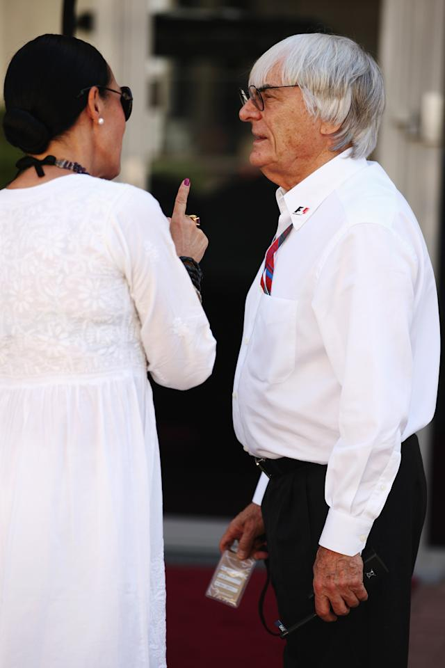 ABU DHABI, UNITED ARAB EMIRATES - NOVEMBER 12:  F1 supremo Bernie Ecclestone talks in the paddock prior to qualifying for the Abu Dhabi Formula One Grand Prix at the Yas Marina Circuit on November 12, 2011 in Abu Dhabi, United Arab Emirates.  (Photo by Ker Robertson/Getty Images)