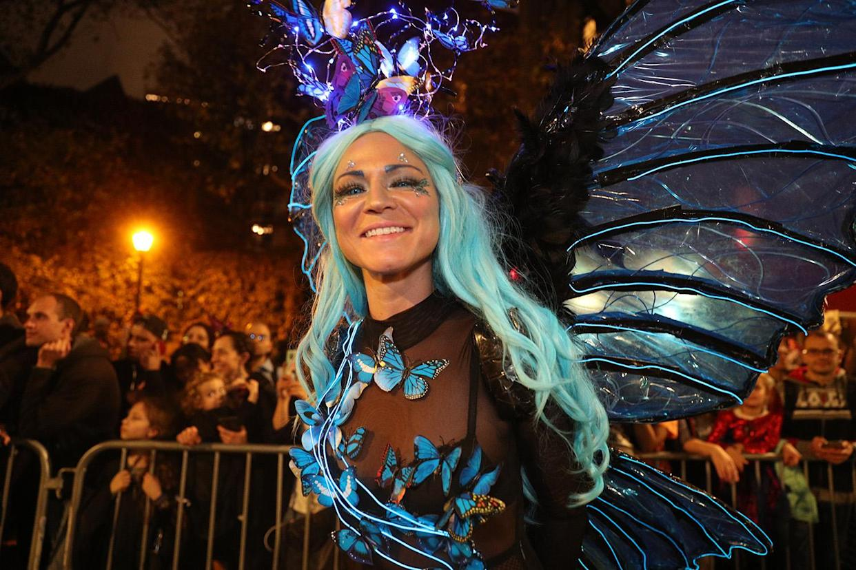 A reveler wearing a butterfly costume marches in the Village Halloween Parade in New York City. (Photo: Gordon Donovan/Yahoo News)