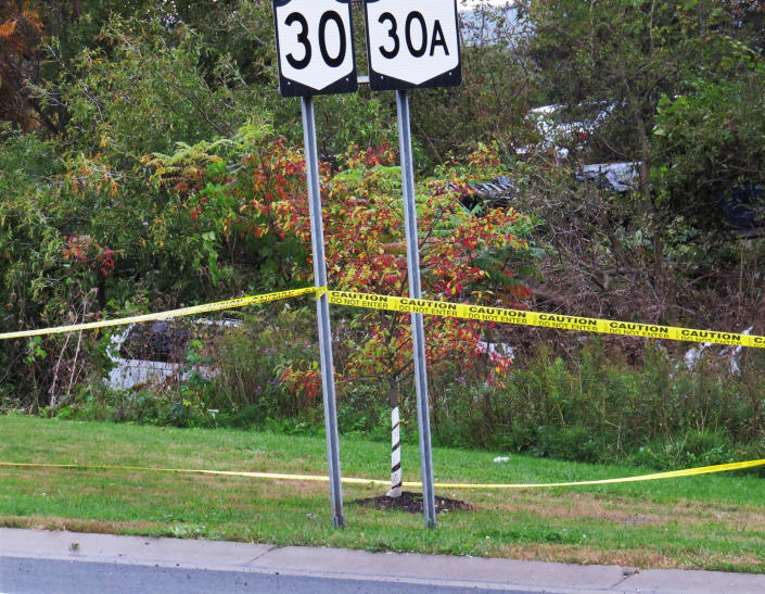 In this Saturday, Oct. 6, 2018 photo, a limousine, left, has landed in the woods following a fatal crash in Schoharie, N.Y. (Tom Heffernan Sr. via AP)