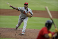 St. Louis Cardinals pitcher Carlos Martínez, left, pitches to Atlanta Braves' Ronald Acuna Jr. in the first inning of a baseball game Friday, June 18, 2021, in Atlanta. (AP Photo/Ben Margot)