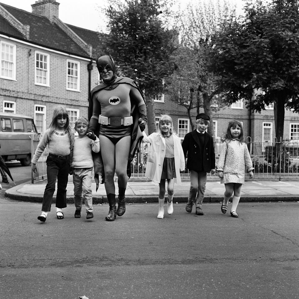 Adam West as Batman helps out with road safety campaign in London which is being sponsored by the Ministry of Transport, 7th May 1967. (Photo by Freddie Cole/Mirrorpix/Getty Images)  - Getty