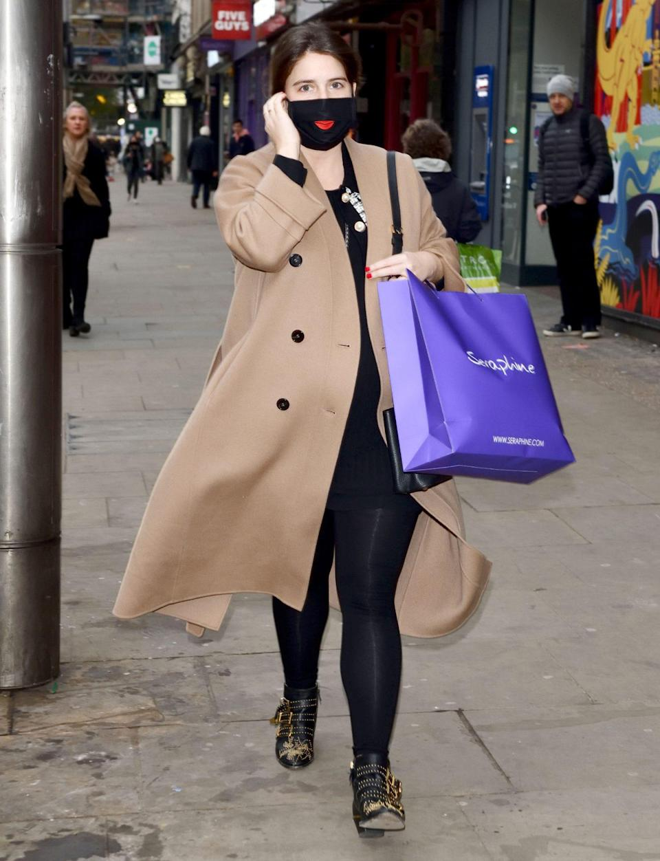 <p>Princess Eugenie leaves Seraphine on Kensington High Street with a bag full of goodies after the store reopened on the first day after lockdown in London on Wednesday. </p>