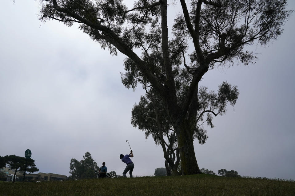 Carlos Ortiz, of Mexico, hits on the fairway of the 18th hole during a practice round of the U.S. Open Golf Championship Monday, June 14, 2021, at Torrey Pines Golf Course in San Diego. (AP Photo/Gregory Bull)