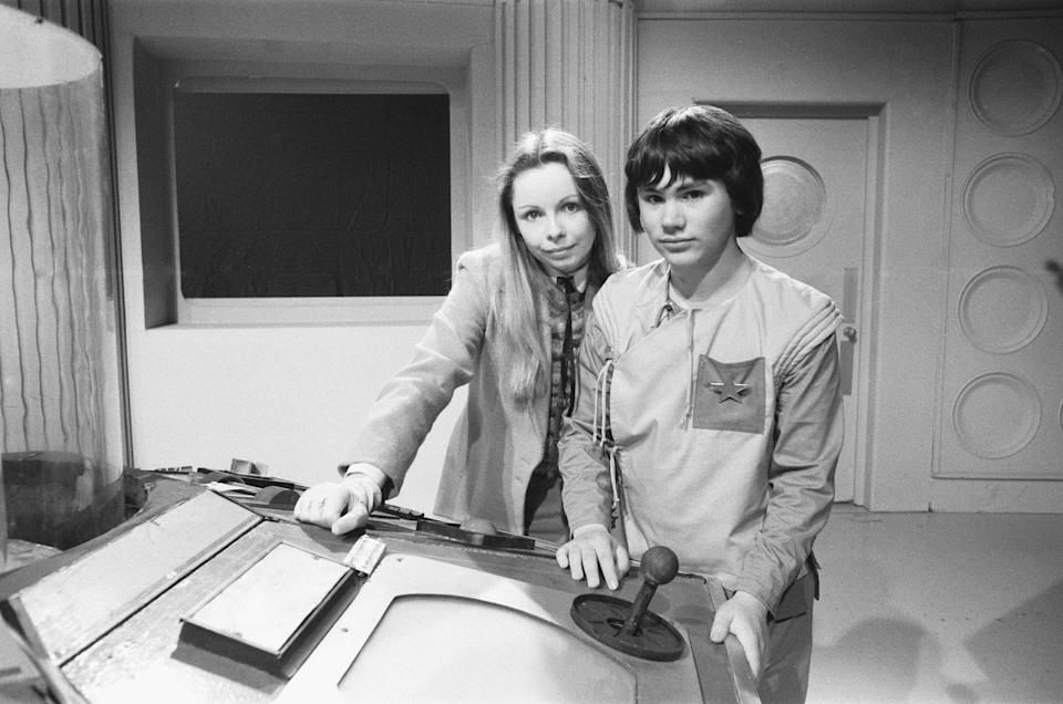 18 year old Matthew Waterhouse making his debut in the BBC TV series Dr Who. Waterhouse will play the part of Adric and seen here with Lalla Ward on the set of the Tardis at BBC TV centre, 15th May 1980. (Photo by Bill Kennedy/Mirrorpix/Getty Images)