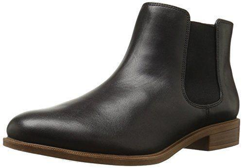 """<p><strong>Clarks</strong></p><p>amazon.com</p><p><strong>$120.00</strong></p><p><a href=""""https://www.amazon.com/dp/B00THDGEPG?tag=syn-yahoo-20&ascsubtag=%5Bartid%7C2164.g.37678622%5Bsrc%7Cyahoo-us"""" rel=""""nofollow noopener"""" target=""""_blank"""" data-ylk=""""slk:Shop Now"""" class=""""link rapid-noclick-resp"""">Shop Now</a></p><p>These classic black Chelsea boots go with nearly any outfit! You can style them with a pair of skinny jeans just as easily as you can with a dress this fall and winter. </p>"""