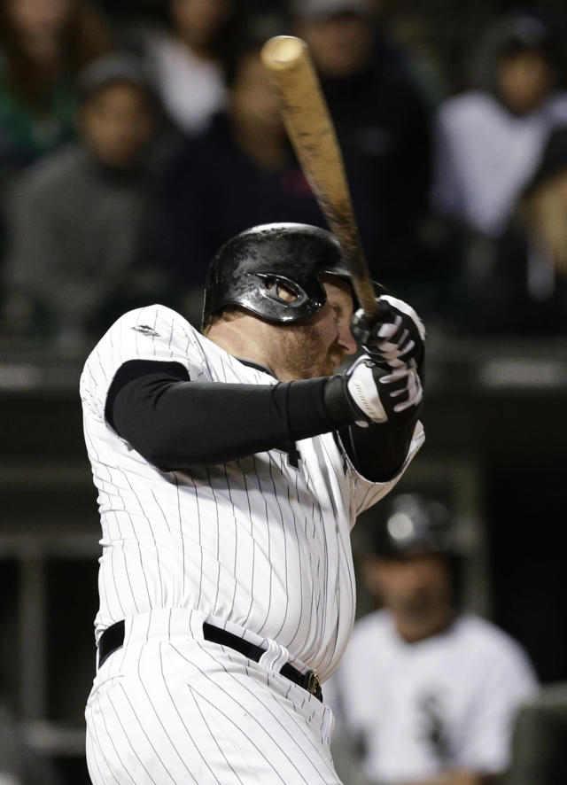 Chicago White Sox's Adam Dunn follows through on the game-winning two-run home run against the New York Yankees during the ninth inning of a baseball game in Chicago on Friday, May 23, 2014. The White Sox won 6-5. (AP Photo/Nam Y. Huh)